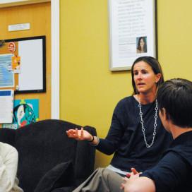 Brandi Chastain, speaking at women's community center