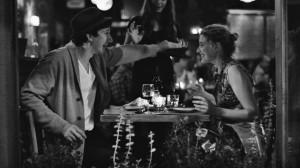 "Greta Gerwig with Adam Driver having dinner in ""Frances Ha."" Copyright Pine District, LLC."