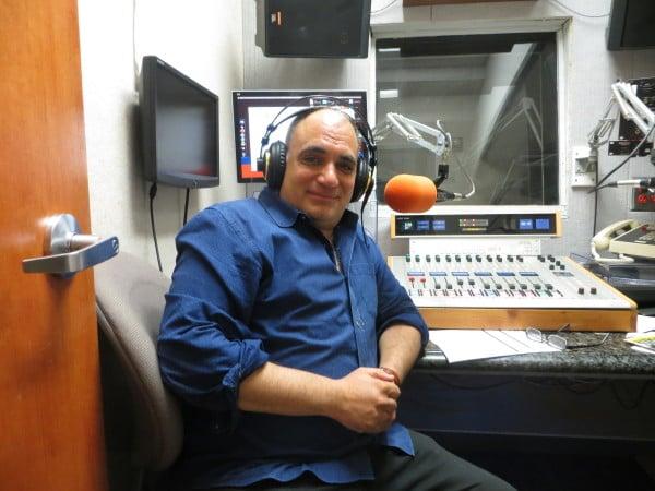 Dr. Ramzi Salti in the studio of his KZSU station. (ANDREA VILLA/The Stanford Daily)