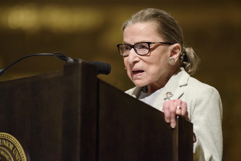 Ruth Bader Ginsburg speaks at a podium at Stanford.