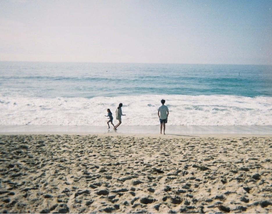 Tara's mother and siblings on a California beach
