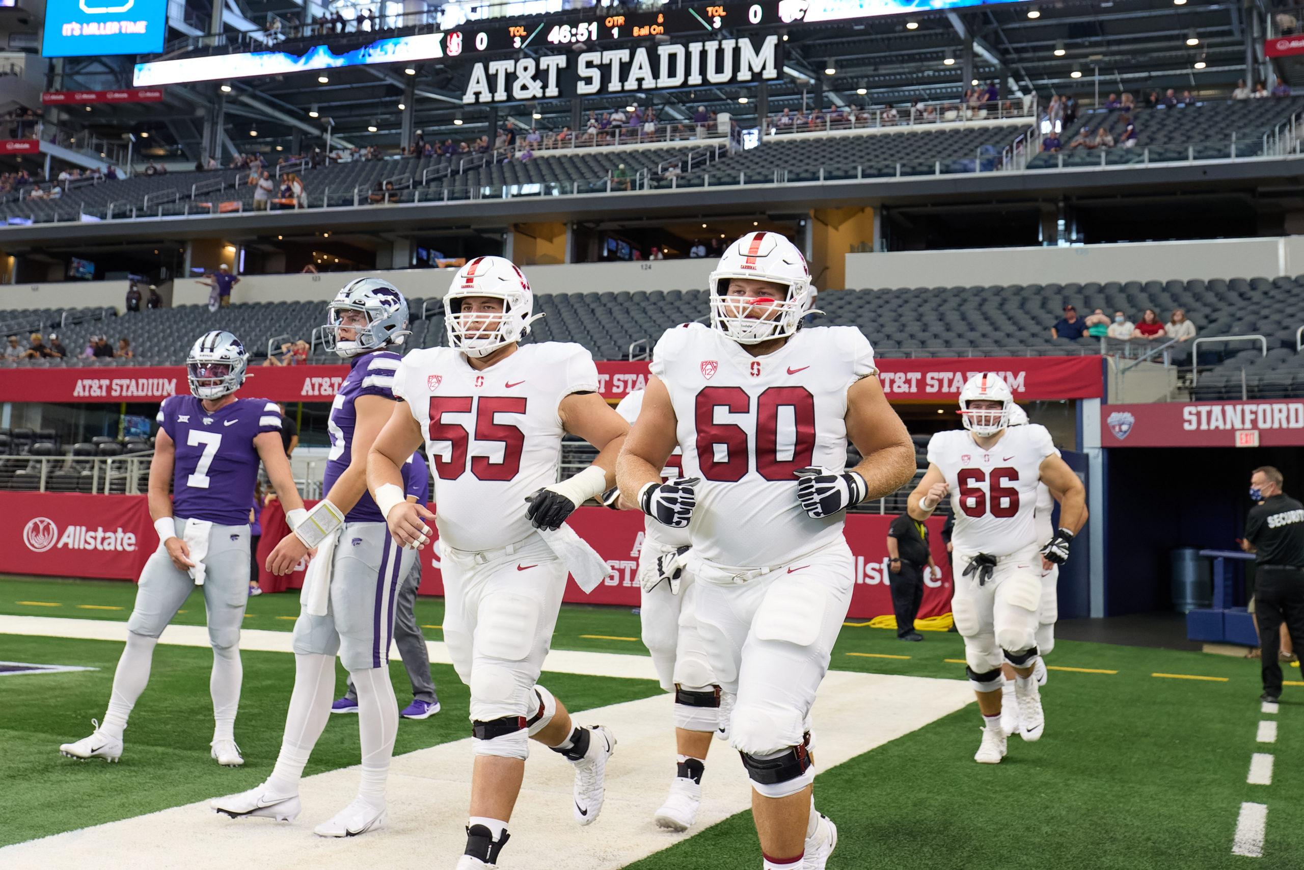 Stanford football's Drake Metcalf and Drake Nugent jog onto the field at AT&T Stadium.