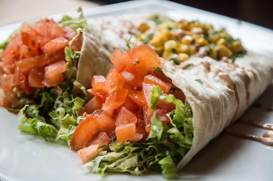 A burrito split lengthwise
