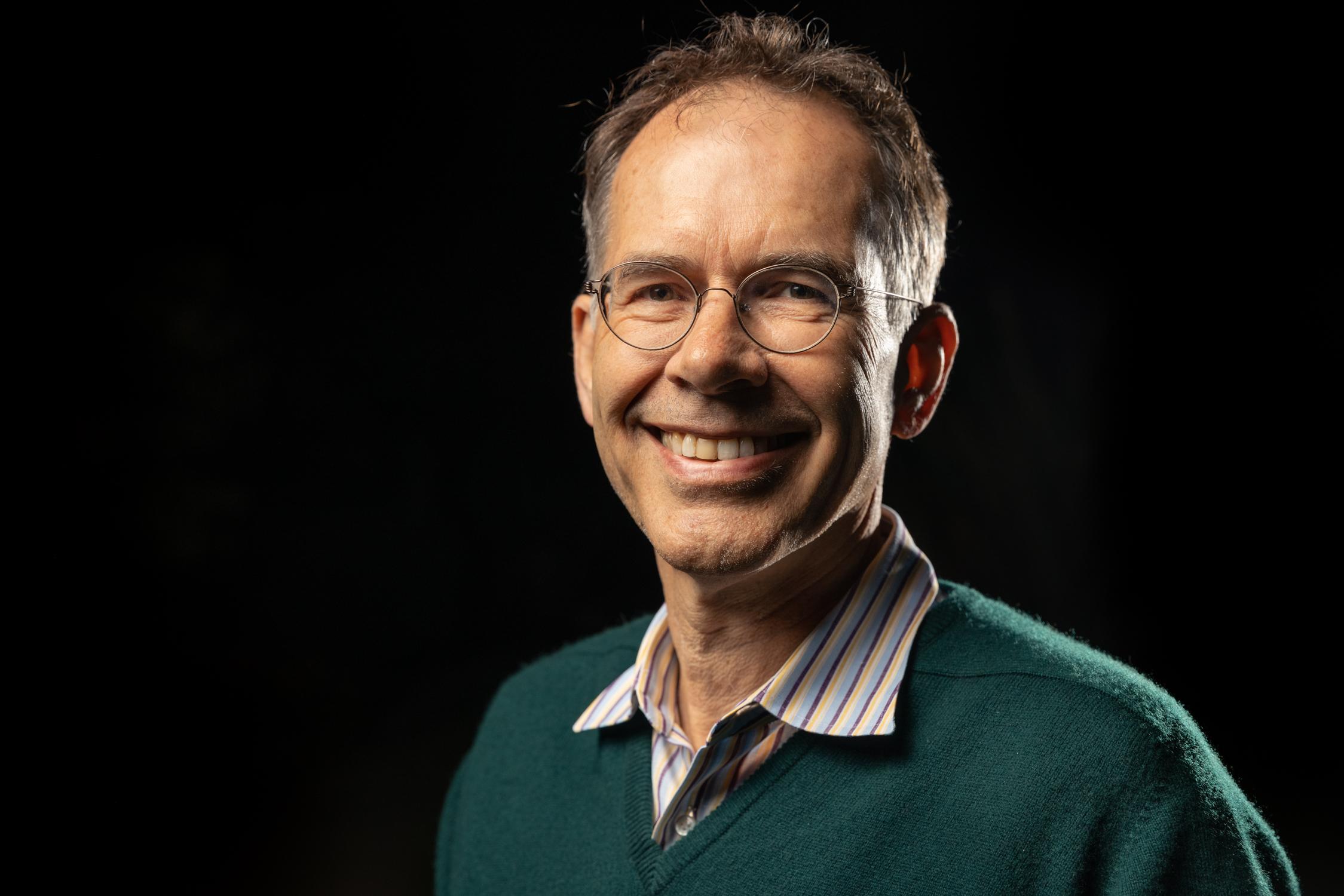 A headshot of Stanford economics professor Guido Imbens